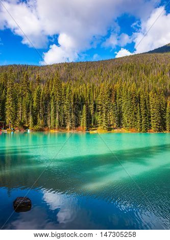 Emerald Lake, Yoho National Park, Canada. Beautiful lake with blue - green water, surrounded by wooded mountains