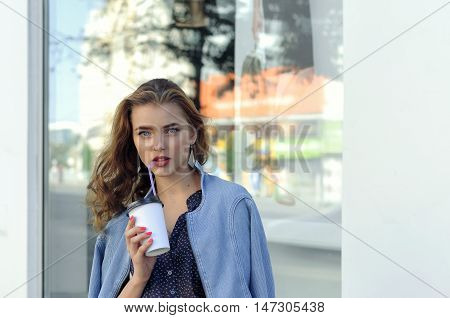 Woman Drinks Juice From A Paper Cup