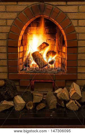 Wooden Logs And Fire In Fireplace