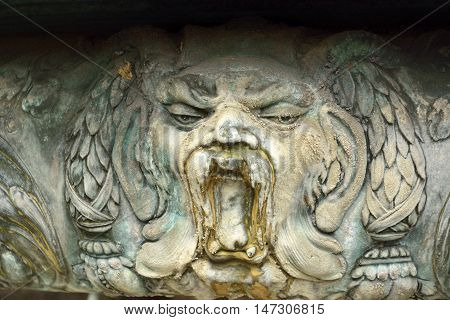 Decorative detail of Oskar-Winter-Brunnen dating from 1896 in Hanover, Germany, depicting a face.