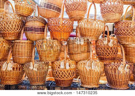 Pile of traditional handmade wicker baskets at street market
