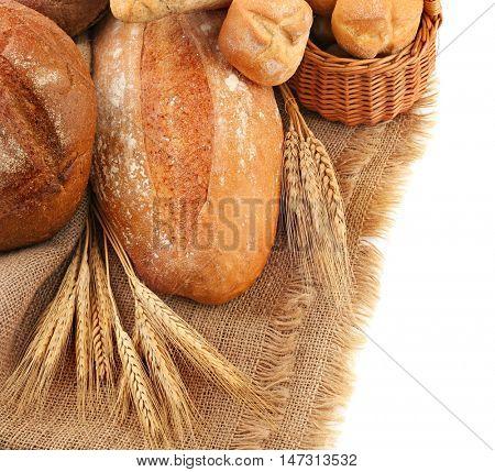 Fresh bread on sackcloth, closeup