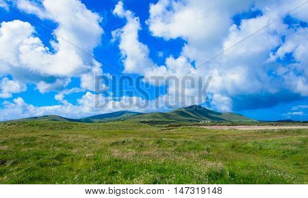 Dingle green landscape, grass, sky and hills