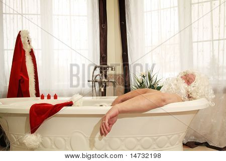 Santa Claus relax in a bath