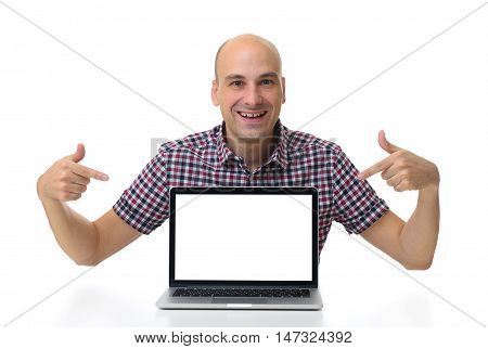 Man Sitting At Desk And Pointing On Laptop With Blank Screen