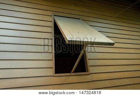 very typical wooden window of northeast Thailand house