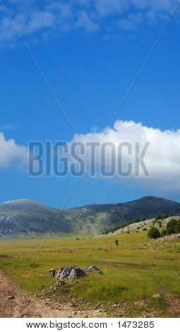 Dinara Mountain Over Blue Sky 6
