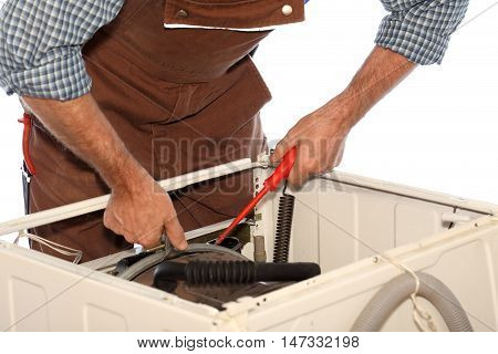 repairman is working on a damaged washer