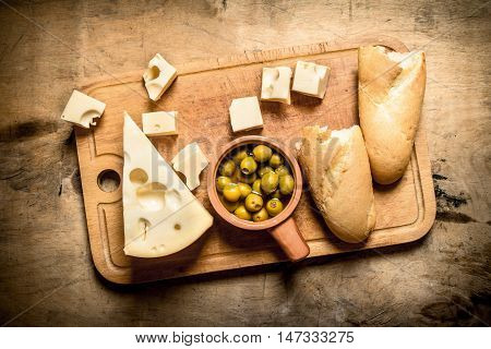 Ciabatta with cheese and fragrant olive on the Board.