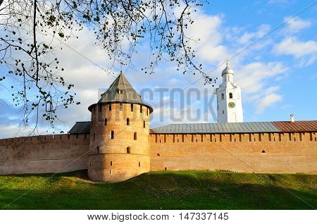 Metropolitan tower and Clock Tower in Novgorod Kremlin at colorful autumn sunset in Veliky Novgorod Russia - selective focus at the fortress. Architecture autumn landscape