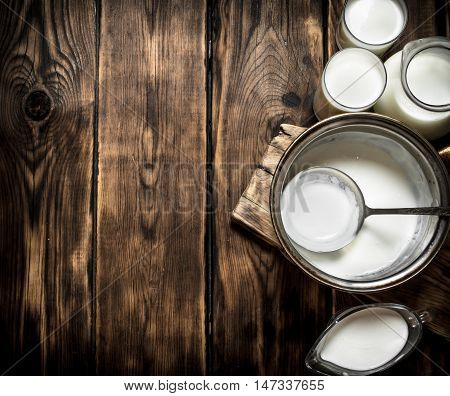 Fresh dairy products on the wooden table .