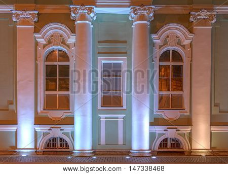 St. Petersburg Russia - July 12 2016: Several windows and columns in a row on night illuminated facade of the State Hermitage Museum front view