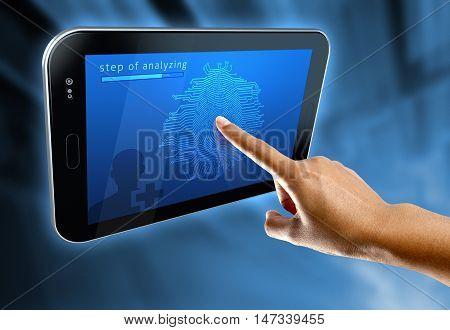A woman's finger scanning her fingerprints. on a digital tablet