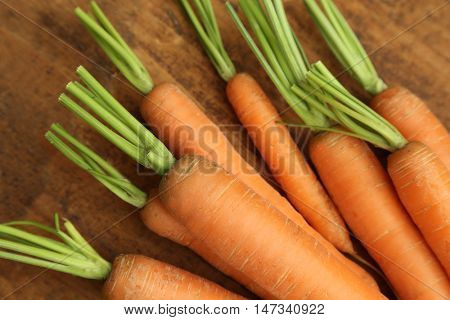 carrots on wooden table.