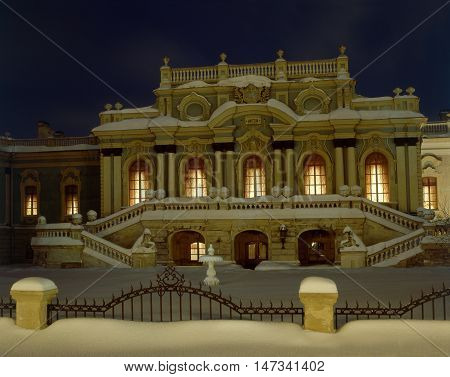 Illuminated Mariyinsky Palace (Kiev). Building is powdered with snow.