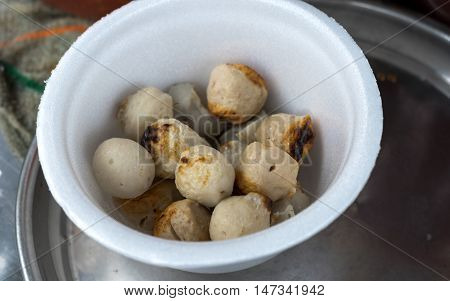 Grilled meat ball with sweet spicy sauce in styrofoam cups