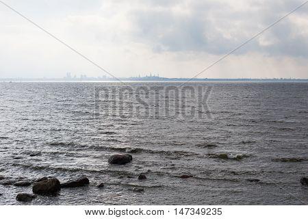 Gray, stormy sea and Tallinn city skyline in Europe