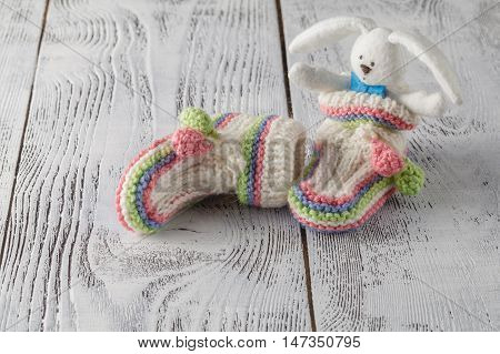 Newborn Announcement Concept. Knitted Booties On Aquamarine Background
