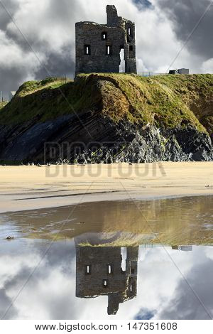 wild atlantic way castle and beach with beautiful reflections