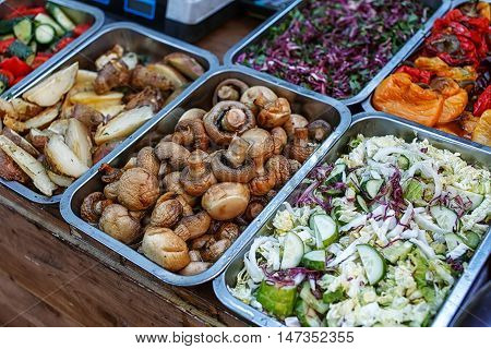 catering food buffet. Grilled mushrooms and potato
