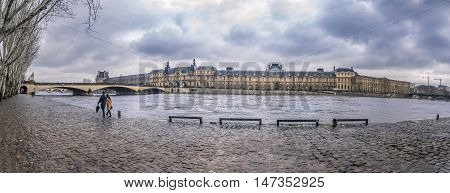 The Seine River and its shore on a rainy day - The river Seine a walk path on one shore and historical french buildings on the other one. Picture taken in Paris France.