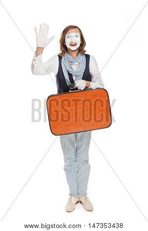 mime actor with orange suitcase someone welcomes