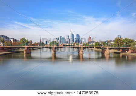 Daytime view of Frankfurt city skyline with Alte Brucke bridge