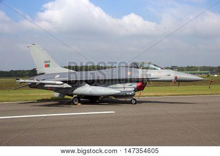 KLEINE BROGEL BELGIUM - SEP 13 2014: Portuguese Air Force F-16 fighter jet on the tarmac of Kleine Brogel airbase.