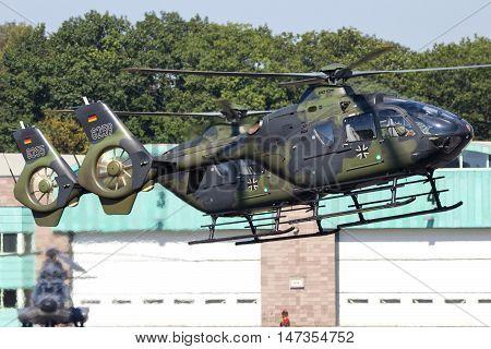 GILZE-RIJEN THE NETHERLANDS - SEP 7 2016: Two German Army Eurocopter EC135 helicopters landing on Gilze-Rijen airbase.