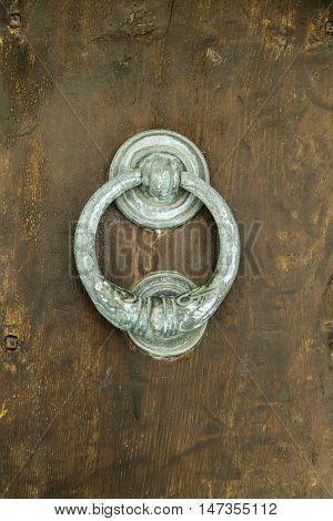 Ancient Door Knocker Detail Of Wooden Door