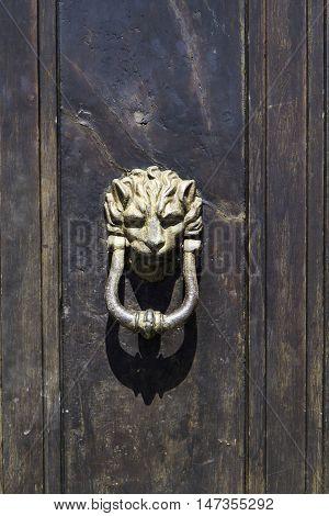 Ancient Bronze Door Knocker Detail Of Wooden Door