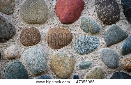 The stones embedded in the concrete foundation and background