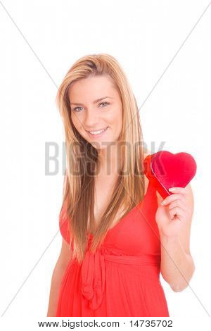 beautiful and young woman with a heart gift over white