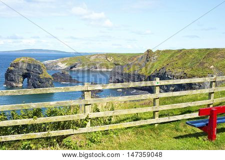 seat with view of virgin rock near cliffs on the wild atlantic way in ballybunion county kerry ireland