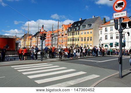 Copenhagen: aug 15. 2016 - Turist on the Nyhavn district is one of the most famous landmark in Copenhagen
