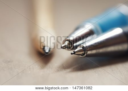 stylus pencil and a pen are on the table close-up