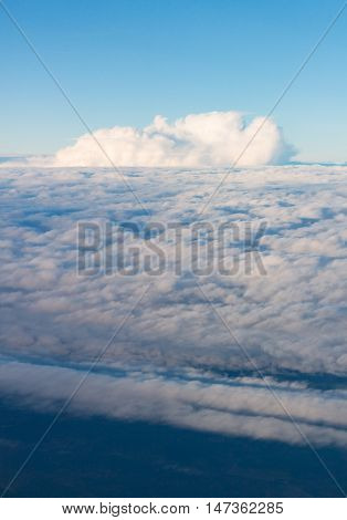 View from airplane window at the clouds in the daytime