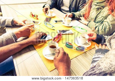 Friends having coffee break at cafe bar restaurant - Black and white hands holding espresso cup around table winter interior scene - Concept of togetherness and caffeine consumption - Vintage filter