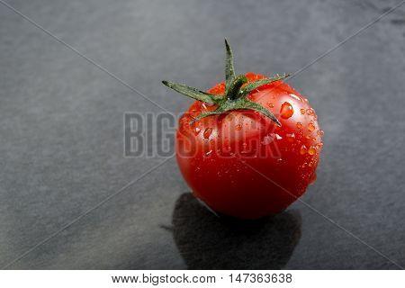 Cherry Tomatoes On Black Slate