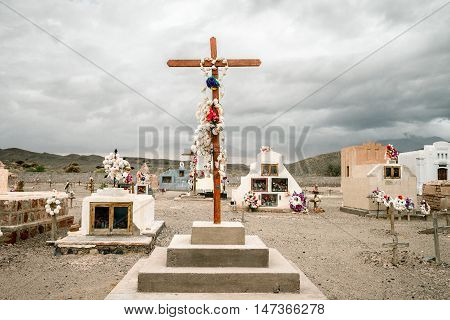 Great Cross With Flowers In A Small Cemetery In Catamarca, Argentina