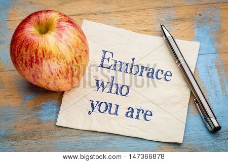 Embrace who you are - handwriting on a napkin with a fresh apple