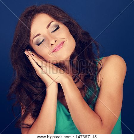 Beautiful Makeup Tired Young Woman Want To Sleep And She Lying On Her Hands On Blue Background. Clos