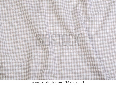 the Crumpled fabric texture light tablecloth background