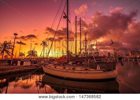 Beautiful panorama of sailing boats docked at the Ala Wai Harbor at sunset the largest yacht harbor of Hawaii situated between Waikiki and downtown Honolulu in Oahu Hawaii.