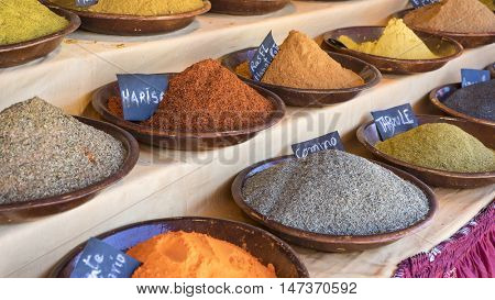 Bowl variety of colorful spices and different flavors, spices traditional cooking