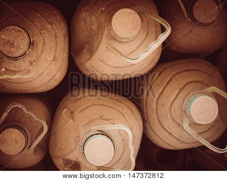 Stack Of Huge Dusty Water Bottles