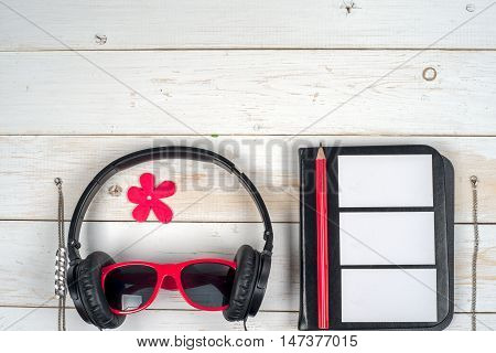 Women accessories on white wooden background. Red and black. Top view