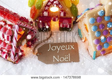Label With French Text Joyeux Noel Means Merry Christmas. Colorful Gingerbread House On Snow And Snowflakes. Christmas Card For Seasons Greetings