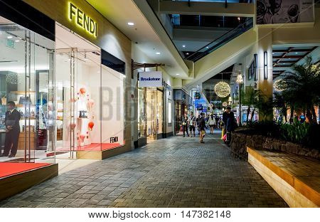Honolulu, Hawaii, USA - Dec 21, 2015: Night view of public pathway at the popular Ala Moana Center. This area is usually frequented by many visitors.