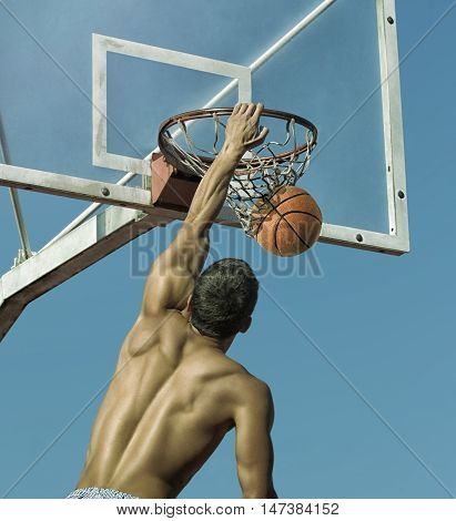 Sport. Basketball player in action -- toned and stylized photo